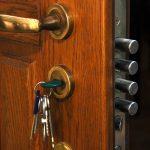 close-up safe lock in the open home wood door