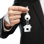 businessman gives keys to house